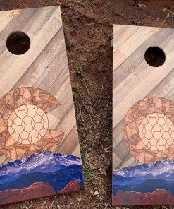 Painted Colorado mountains cornhole game
