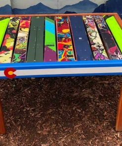 Repurposed ski side table with Colorado flag front board