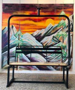 Repurposed vintage metal ski lift bench